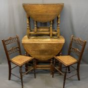 OAK BARLEY TWIST GATELEG DINING TABLE & ONE OTHER with two Edwardian cane seated side chairs,