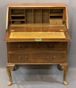 VINTAGE BURR WALNUT FALL-FRONT BUREAU with interior drawers and pigeonholes over three drawers on