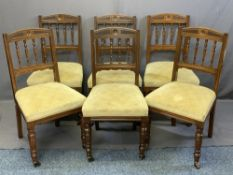 SET OF SIX EDWARDIAN OAK PARLOUR/DINING CHAIRS with carved top rail and spindle back, stuff over