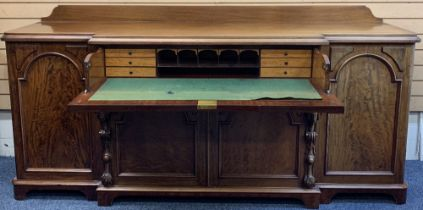 GOOD VICTORIAN MAHOGANY SECRETAIRE BREAKFRONT SIDEBOARD with shaped back rail over a moulded edge