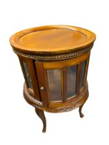 REPRODUCTION HARDWOOD DRUM TYPE DRINKS CABINET having a lift-off circular tray top, beaded and