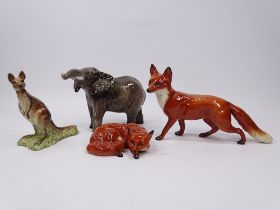 BESWICK MODELS (4) Elephant, Kangaroo and two foxes A/F