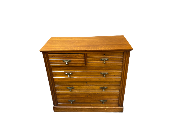 EDWARDIAN MAHOGANY CHEST of two short over three long drawers with stylised acorn drop brass handles