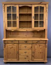 REPRODUCTION PINE GLASS TOP DRESSER having twin upper glazed doors and central shelving over a