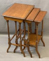 EDWARDIAN MAHOGANY NEST OF THREE OCCASIONAL TABLES with beaded edge detail on turned and splayed