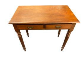 CIRCA 1900 MAHOGANY TWO DRAWER HALL TABLE on turned supports, 76.5cms H, 83.5cms W, 47cms D