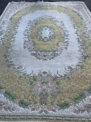 OLD ENGLISH STYLE EASTERN WOOLLEN CARPET, cream ground with yellow and floral oval cameo and