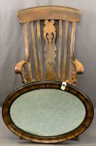 ANTIQUE FARMHOUSE ARMCHAIR and a vintage oval wall mirror, the chair high back with curved top