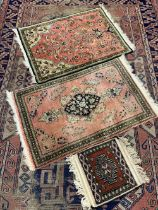 ANTIQUE & LATER EASTERN RUGS including a 210 x 144cms blue and red ground example, traditionally
