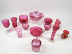 CRANBERRY & RUBY GLASSWARE, A COLLECTION - 13 pieces to include footed bowls, stem vase, enamel