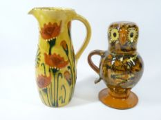 SLIPWARE POTTERY JUGS (2) including 'Ozzy The Owl' example, the head formed as a cup, the other