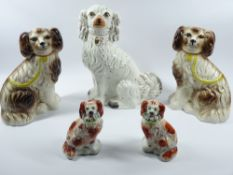 STAFFORDSHIRE COMFORTER DOGS, A PAIR - red and white with flower baskets in mouths, 16cms tall and