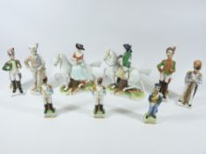 CONTINENTAL PORCELAIN MILITARY FIGURINES and a similar lady and gent on horseback, a pair
