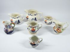 GAUDY WELSH GRADUATED SET OF THREE OCTAGONAL JUGS, 15cms tall, and an assortment of other Gaudy