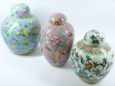 THREE MODERN CHINESE FAMILLE ROSE PORCELAIN JARS & COVERS, variously decorated with lotus,