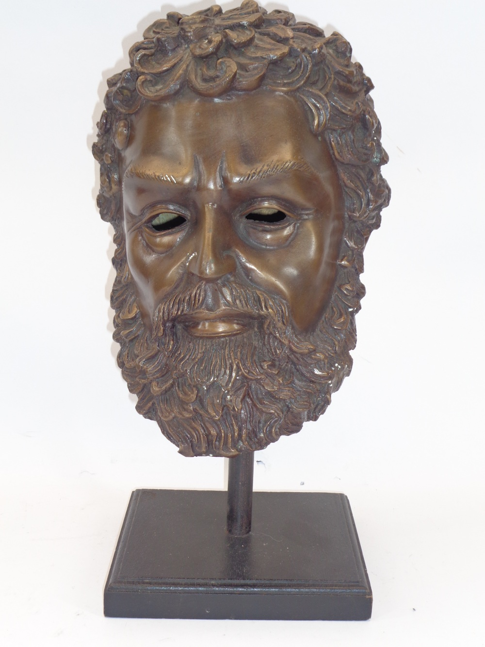 REPRODUCTION BRONZE ANTIQUITIES STYLE HEAD - a bearded man mounted on a wooden base, 46cms H