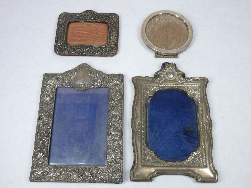 SILVER FRONTED PHOTOGRAPH FRAMES (4) - Birmingham hallmarks, various dates and conditions, 21.5 x