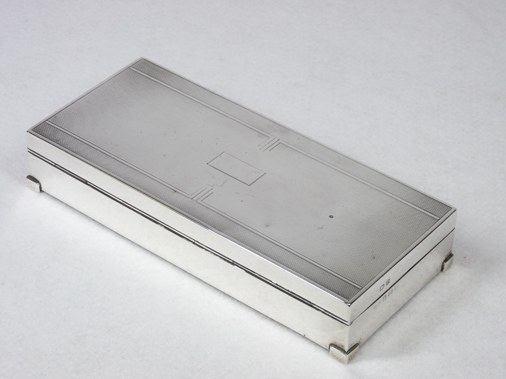 AN OBLONG ENGINE TURNED SILVER MOUNTED CIGARETTE BOX with two interior compartments and on neat - Image 2 of 3
