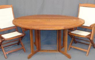 GARDEN FURNITURE - teak effect circular table, 1.5m diameter (foldable) and a pair of similar