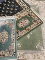 EASTERN/ORIENTAL STYLE WOOLLEN CARPETS (4) - in various greens with traditional and floral central