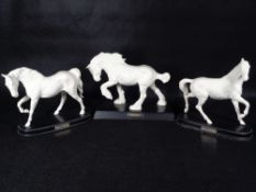 BESWICK POTTERY HORSES (3) - in matt white on titled wooden bases to include 'Spirit of The