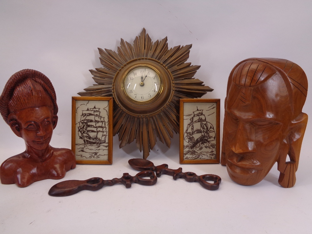 VINTAGE STARBURST WALLCLOCK, carved heads, modern love spoons and two needlework images of clipper