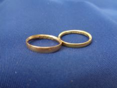 18 & 22CT GOLD WEDDING BANDS (2) - 1.4grms, size K and 2.8grms size mid M-N respectively