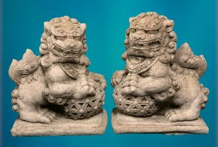 GARDEN STONEWARE - reconstituted statuary Chinese Temple lions, a pair holding an open carved ball