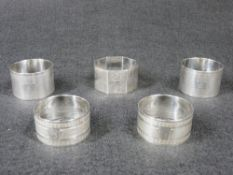 NAPKIN RINGS - 1. A pair of sterling silver engine turned wide rings, each with a small initial, 1.