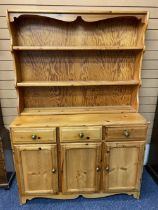 REPRODUCTION PINE KITCHEN DRESSER - having a three shelf rack over a base section of three frieze