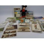 VINTAGE POSTCARDS, CIGARETTE CARDS, TEA CARDS with a small cloth figure of Mickey Mouse