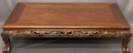 20TH CENTURY CHINESE HARDWOOD OVERSIZE COFFEE TABLE - lower carved frieze detail and mask corners on