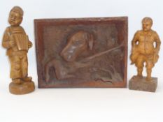 RUSTIC DEEP CARVED GUN DOG WITH GAME PANEL and two standing figurines of a young boy with