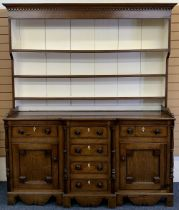 NORTH WALES OAK BREAKFRONT DRESSER - 19th century, painted interior deep shelf rack, the base with a