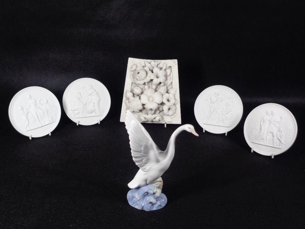 ROYAL COPENHAGEN CIRCULAR RELIEF PLAQUES (4), Nao swan figure and a marble panel with carved flowers