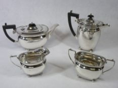 A FOUR PIECE SILVER TEA & COFFEE SERVICE - each piece of oval plain form with four ball supports and