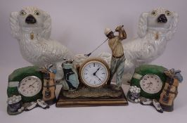 WHITE STAFFORDSHIRE COMFORTER DOGS, A PAIR and three golfing interest composition clocks