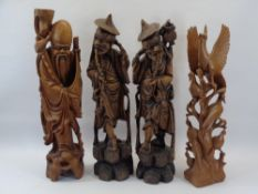 CHINESE & OTHER WOOD CARVINGS (4) - depicting two elderly pipe smoking men, a bearded figure with