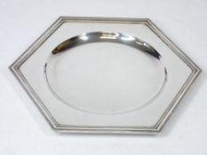 A SILVER ART DECO HEXAGONAL DISHED WAITER - Sheffield 1934, 18ozs