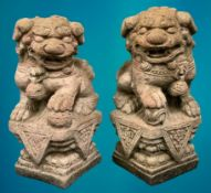 GARDEN STONEWARE - reconstituted statuary depicting Chinese Temple Lions, a pair, holding a ball