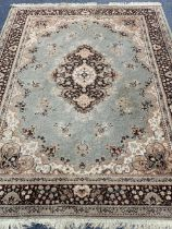 BELGIAN WOOLLEN RUG BY 'BAGHDAD' - tonal browns and greens with central medallion and multi-bordered