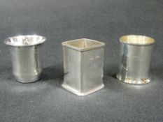 TWO SILVER BOTTLE HOLDERS - 1. Plain square, Birmingham 1943, 3ozs, 7cms H and, 2. Plain circular,