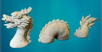 GARDEN STONEWARE - reconstituted statuary of a writhing dragon in three sections, 45cms H the head