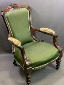 EDWARDIAN MAHOGANY GENTLEMAN'S UPHOLSTERED ELBOW CHAIR - on turned feet with carved detail, 96cms H,