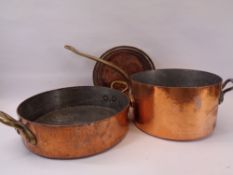 ANTIQUE COPPER & BRASS COOKING PANS, LARGE & HEAVY - a shallow circular pan with twin brass carry