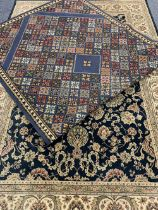 EASTERN STYLE BLUE GROUND CARPETS (2) - a repeating colourful floral pattern with bordered edge