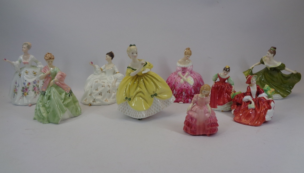 ROYAL DOULTON LADY FIGURINES (8) and one Royal Worcester titled 'First Dance 3629', the Doulton's