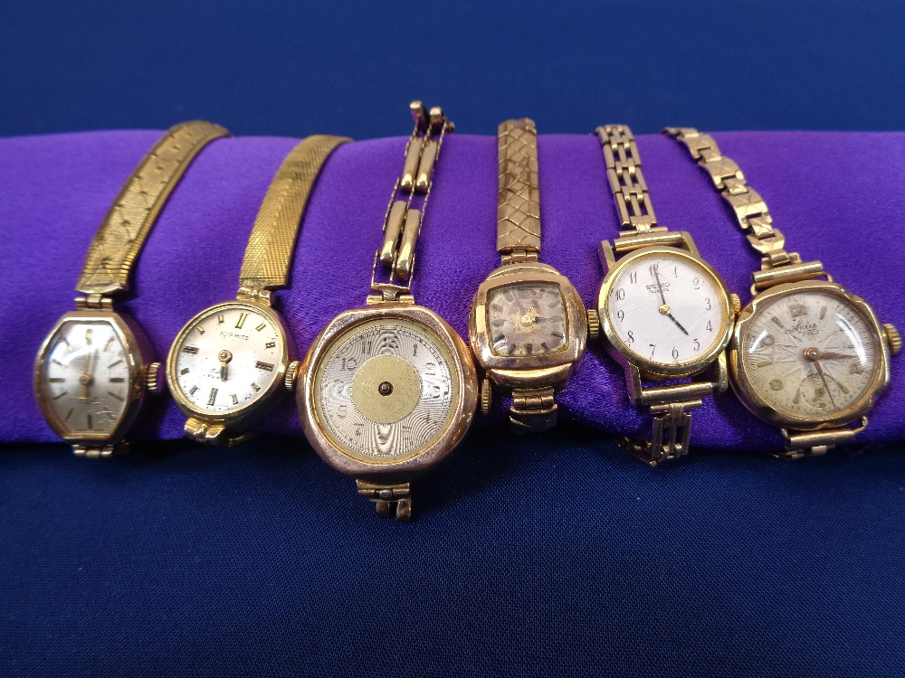 LADY'S 9CT GOLD WRISTWATCHES (6) - five being 9ct gold cased with plated bracelet straps, the