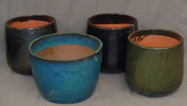 GARDEN STONEWARE - a trio of glazed pots, 35cms tall and 33cms diameter at top, and another