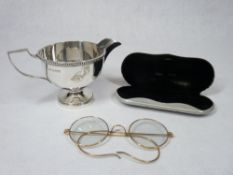 SILVER PEDESTAL CREAM JUG - Sheffield 1957, maker Walker & Hall, 4 troy ozs and a pair of gilt